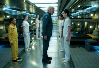 HARRISON FORD (center) and ASA BUTTERFIELD (right) star in ENDER'S GAME